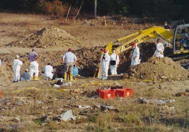During the excavation of the Flight 93 crash site watchers were stationed around the pit, hoping to spot the bright orange color of the boxes.