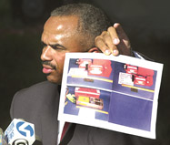 "At a press briefing on September 12, 2001, FBI Assistant Special Agent in Charge Roland Corvington holds up a photo of the black boxes they hope to recover at the Flight 93 crash site.  ""The search will be painstaking,"" Corvington said.  ""The value of the black box and the information therein cannot be overstated.  Until we recover that, we won't be able to answer any of the questions you're asking.""  (""Painstaking search begins in Shanksville,"" Mike Faher, Johnstown Tribune-Democrat, September 13, 2001)"